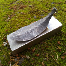 Iron made leaf paper weight